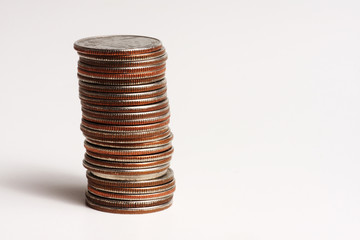 Stack of United States quarters on a white background