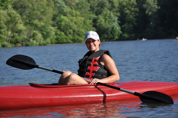 Cute Young Woman Kayaking