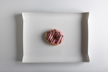 Single doughnut in cardbard box