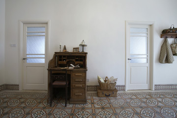 Cyprus, writing desk in entrance hall of 1950's town house