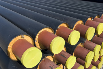 Heap of steel tubes for heating covered with foam and plastic