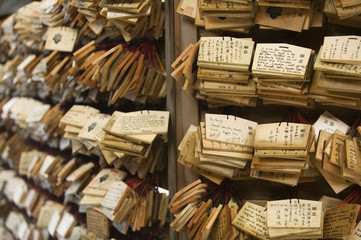 Japan, Tokyo, Meiji-jingu Shinto Shrine, Small wooden plaques with prayers and wishes Ema