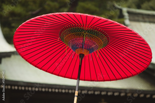 Japan, Tokyo, Meiji-jingu Shinto Shrine, traditional red umbrella