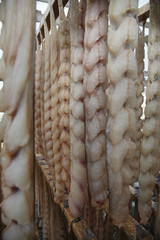 fish fillets hanging to dry