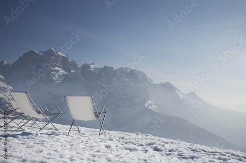 Lawn chairs on mountain peak