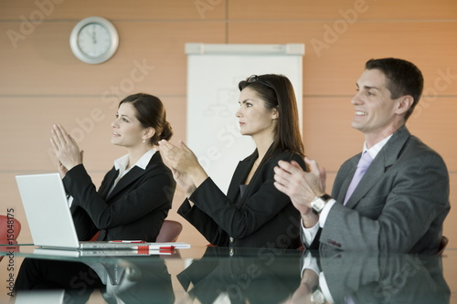 Business people at presentation clapping