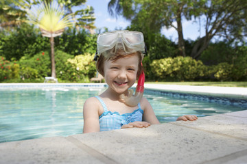 Girl 5-6 snorkelling in swimming pool, portrait