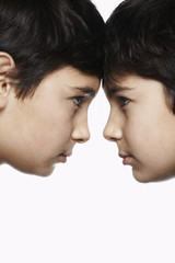 Twin boys 13-15 head to head, close-up