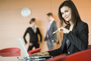 Businesswoman at meeting with laptop