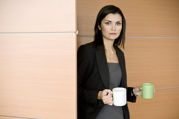 Businesswoman with coffee cups