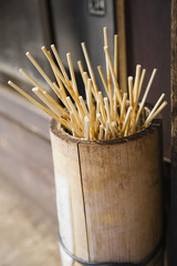 Japan, Takayama, Skewers for Japanese dumplings Dango in wooden bucket