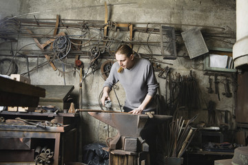 Blacksmith Working in Shop