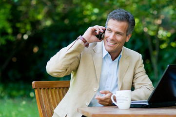 Healthy businessman working outdoor