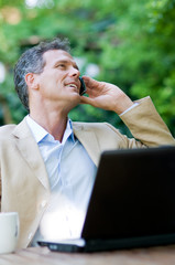 Businessman on mobile outdoor