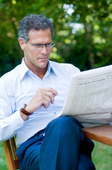 Mature man reading news