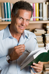 Mature man reading book