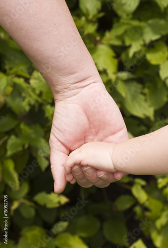 Mother and child holding hands