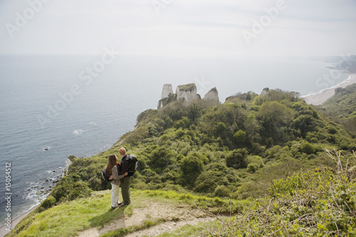 Couple Standing on an Outlook Above the Water