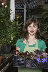 Woman with a Tray of Potted Plants