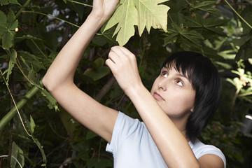 Woman Examining Leaf
