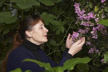 Woman Examining Flowers