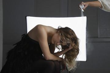 Fashion Model Having Hair Sprayed at Photo Shoot