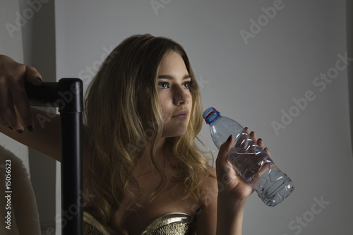 Fashion Model Drinking Water During Photo Shoot