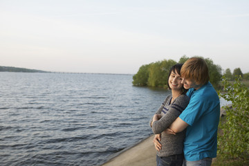 Young Couple Cuddling on Lakeshore