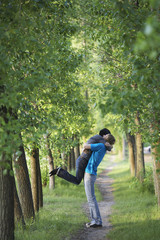 Young Couple Hugging on Tree Lined Path