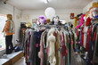 Clothing and Wigs in Crowded Second Hand Store