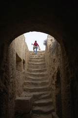 woman climbing stairs in the tombs of the kings paphos cyprus