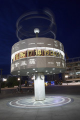 world time clock berlin at night