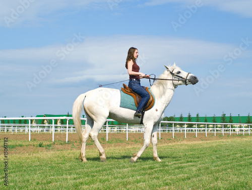 girl astride a horse on a hippodrome