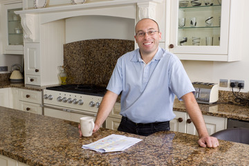 Happy man in modern kitchen
