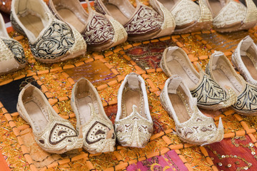dubai uae genie style sandals are for sale in the bur dubai souq in women's and children's sizes.