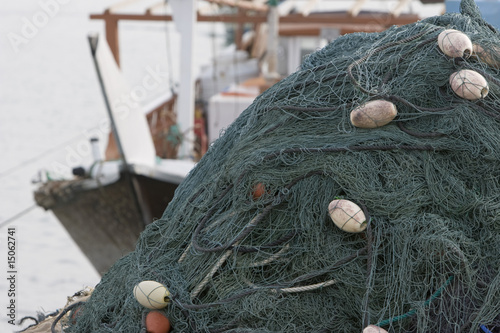 kalba uae fishing nets piled high on boat in kalbar fujairah