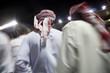 dubai uae small group of traditionally dressed muslim men roaming grounds at nad al sheba