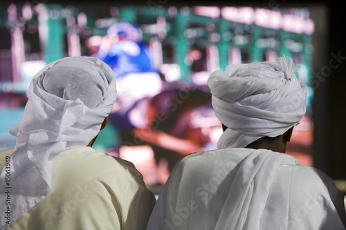 dubai uae two men traditionally dressed in dishdashs and gutras