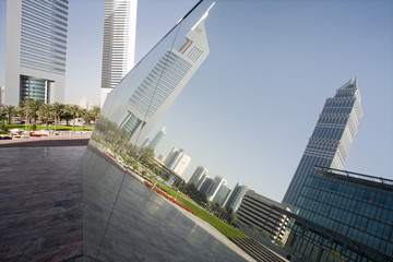 UAE, Dubai, reflection in a mirrored piece of artwork on display at the Dubai International Financial Centre