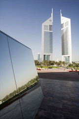 UAE, Dubai, reflection in a mirrored piece of artwork on display at the Dubai International Financi