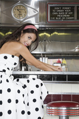 Young Woman Sitting in a Diner