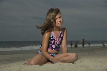 Little Girl Sitting on a Beach
