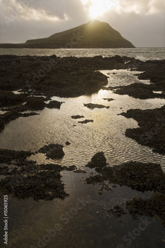 Elevated view of a seashore at sunset