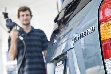Man refueling hybrid car