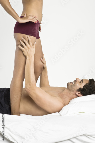 Mid adult couple in bedroom