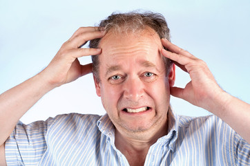Man Suffering from a Migraine or Bad News