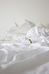 Toy penguin on bed