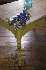 Fallen vase with flowers on table