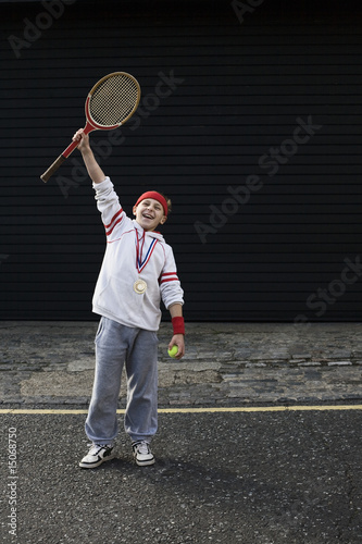 Boy winning tennis match
