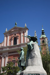 statue and church